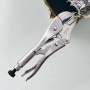 7 inch straight jaw locking pliers being clamped on to a section of HVAC duct