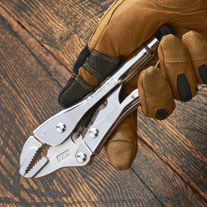 A 7 Inch Eagle Grip Locking Pliers being held by a gloved hand