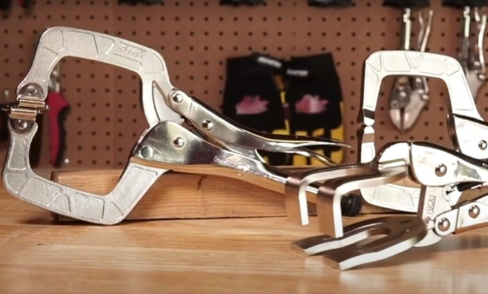 3 Eagle Grip locking clamps standing on a wooden work bench