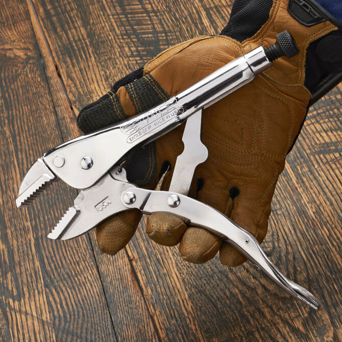 A hand opening a 10 Inch straight jaw locking pliers