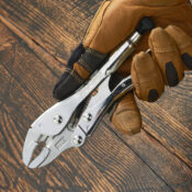 A gloved hand holding a 7 inch long Locking Pliers made with Curved Jaws
