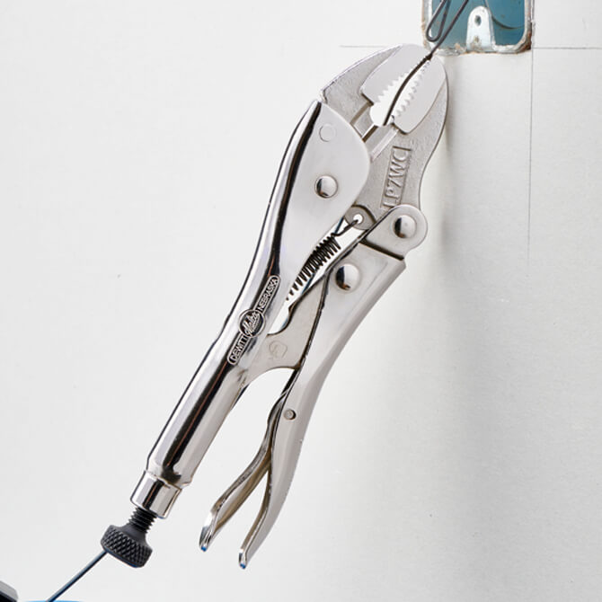 A 7 inch long Eagle Grip Locking Pliers with curved shaped jaws being used on electrical conduit