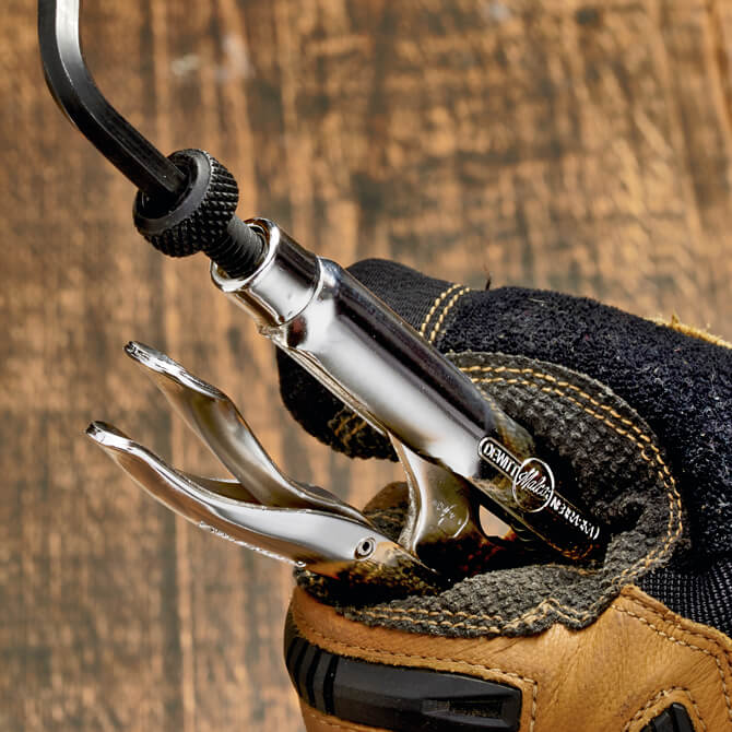 A hand holding an Eagle Grip Locking Pliers and showing the black hex screw